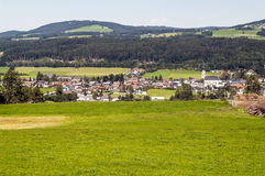 Houses surrounded by meadows Stock Photography