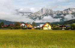 Houses surrounded by meadows Stock Images