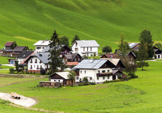 Houses surrounded by meadows Royalty Free Stock Photo