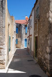 Houses in Susak village near Mali Losinj in Croatia. Stonemade mediterranean houses in narrow street  in Susak village near Mali Losinj island Stock Photo