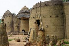 Houses of the tamberma in togo - unesco world heritage. Fetishe in front of a tatienka - the traditionel houses depending to the unesco world heritage stock image