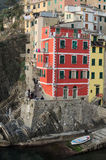 Houses tightly huddled on a rock near the sea. Riomaggiore. Cinq Royalty Free Stock Image