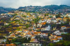 Houses with tiled roofs on the mountainside royalty free stock photography