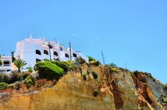 Houses on the top of a cliff Stock Photos