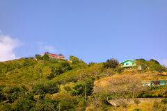 Houses on the top of a hill in the windward islands Royalty Free Stock Photos