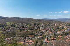 Houses in town Wernigerode in front of Harz mountains. With the mountain Brocken in Germany Stock Images
