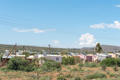 Houses in a township of Willowmore. WILLOWMORE, SOUTH AFRICA - MARCH 23, 2017: Houses in a township of Willowmore, each with a solar water heater on the roof stock photos