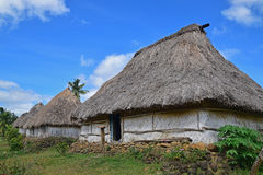 Close up of row of Fijian bure in Navala, a village in the Ba Highlands of northern central Viti Levu, Fiji. These houses are traditional fijian wood and straw Stock Image