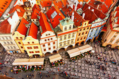 Houses with traditional red roofs in Prague. Old Town Square. Stock Images