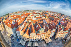 Houses with traditional red roofs in Prague Old Town Square in the Czech Republic. Fish-eye lens.  Stock Images