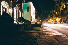 Houses and traffic at night on Drayton Street in Savannah, Georg Stock Image