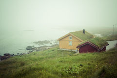 Houses with typical sod roof on Lofotten islands in Norway Royalty Free Stock Image