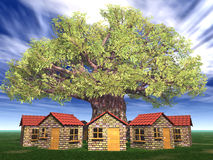 Houses under the big tree Royalty Free Stock Photo