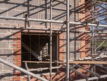 Houses under construction in Cheshire England UK. New build homes in scaffolding on a housing estate in Cheshire England United Kingdom Europe stock photos