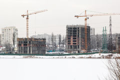 Houses under construction on lake Royalty Free Stock Images