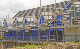 Houses under construction with thermal lagging. An image of a  series of houses under construction with blue thermal lagging in position to make them green Stock Photography