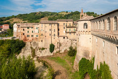 Houses in Urbania, a small village in the italian region of Marche; the Palazzo Ducale on the right Royalty Free Stock Image