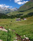 Houses in valley. Houses in green valley in the Alps royalty free stock image