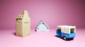 Houses and vehicle model on pink background. For many usage, house, estate, buying, farm, life target ,etc Royalty Free Stock Photo