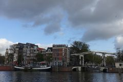 Houses and Walter Suskindbrug next to Amstel river in Amsterdam royalty free stock image