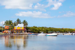 Houses Waterside at Key Largo Florida USA. Kayaks rental shop and boats Stock Photos