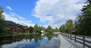 Houses and white lake at Crans Montana, Switzerland Royalty Free Stock Images