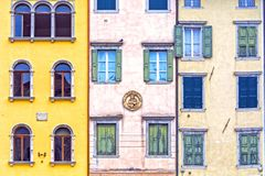 Houses and windows in italian town square royalty free stock photo