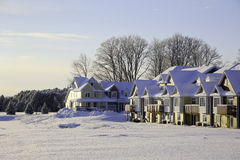 Houses in Winter. A group of row houses covered with snow on winter day Royalty Free Stock Photo
