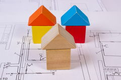 Houses of wooden blocks on construction drawing of house, building house concept Royalty Free Stock Photo