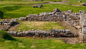 Housesteads Roman Fort. Part of the ruins of the Housesteads Roman Fort at the Hadrian's Wall Royalty Free Stock Photos