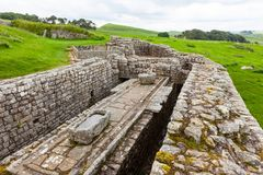 Housesteads Roman Fort. NORTHUMBERLAND, ENGLAND - JULY 7, 2012: The remains of the latrines at Housesteads Roman Fort, part of Hadrian`s Wall in Northumberland Stock Photos