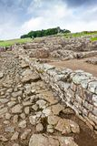 Housesteads Roman Fort. NORTHUMBERLAND, ENGLAND - JULY 7, 2012: The remains of Housesteads Roman Fort, part of Hadrian`s Wall in Northumberland, England Stock Image