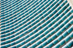 Housetop made of cyan blue glaze tiles Royalty Free Stock Photo