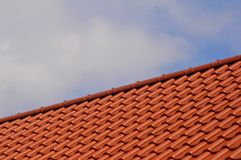 Housetop. Red roof tiles on a house roof Stock Photo
