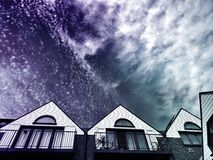 Housetops with night sky
