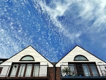 Housetops and sky