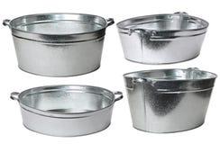 Houseware: zinc-coated washbowl isolated on white background. Four galvanized wash basin isolated on white background Stock Photo