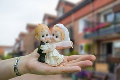 Housewarming and new dwelling of married couple statuette Stock Photography