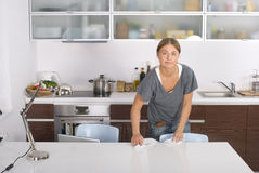 Housewife. Young blonde housewife cleaning a table Stock Photos