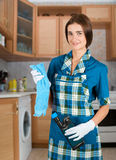 Housewife. Beauty housewife with duster and detergent royalty free stock photography