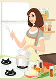 Housewife. Young woman on the kitchen Royalty Free Stock Image