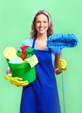 Housewife. Cleaner. Over green background Royalty Free Stock Images