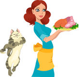 Housewife. Young housewife holds a food on a tray.Cat asks her treats Stock Photo
