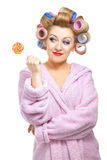 Housewife-23. Housewife in pink bathrobe with lollypop on white background Royalty Free Stock Photography