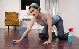 Housewife Wearing Knee Pads Cleaning Wood Floor Stock Photography
