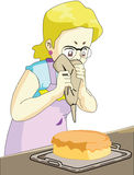 Housewife. Are doing a cake Stock Photography