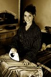 Housewife. Monochrome portrait of a young and pretty housewife ironing royalty free stock photos