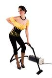 Housewife. In pin up style, hoovering the room royalty free stock photo