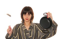 Housewife. Young woman holding a pan in hand Stock Image