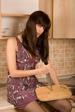 Housewife. Sitting on the table and handing knife Stock Images